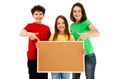 Kids holding noticeboard isolated on white background Stock Images