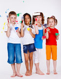 Kids holding paintbrushes and paints. Four kids holding paintbrushes and paints in hands Royalty Free Stock Photos