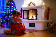 Kids at home on Christmas eve Royalty Free Stock Images