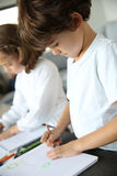 Kids at home drawing pictures Stock Photography