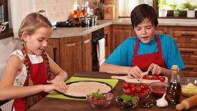 Kids at home making a pizza stock video footage