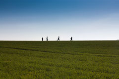 Kids on the horizon Stock Images
