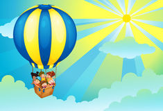 Kids in hot air balloon Stock Image