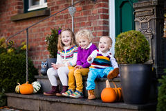 Kids at house porch on autumn day Stock Photos
