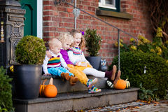 Kids at house porch on autumn day Royalty Free Stock Photos