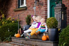 Kids at house porch on autumn day Stock Photography