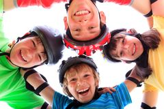 Kids in a huddle Royalty Free Stock Image