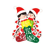 Kids huddled toghether inside a christmas stocking Royalty Free Stock Images
