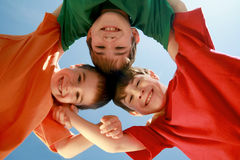Kids Huddling Stock Images