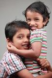 Kids hugging Stock Images