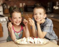 Kids and ice cream. Two kids eating a large banana split Royalty Free Stock Image