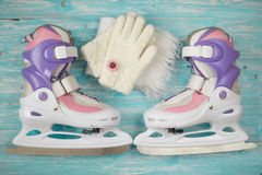 Kids ice skates with adjustable size and accessories on the wooden floor. Stock Image