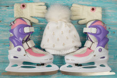Kids ice skates with adjustable size and accessories on the wooden floor. Stock Photo