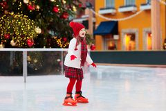 Free Kids Ice Skating In Winter. Ice Skates For Child Royalty Free Stock Photography - 132824177