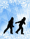 Kids ice skating silhouettes on the abstract background Stock Photos