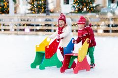 Kids ice skating in winter. Ice skates for child. Royalty Free Stock Photography