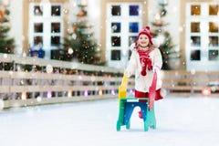Kids ice skating in winter. Ice skates for child. Stock Photos