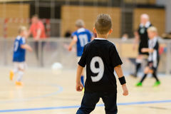Kids indoor soccer match Royalty Free Stock Images