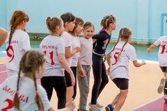 Kids indoors training before handball competition. Sports and physical activity. Training and royalty free stock photo