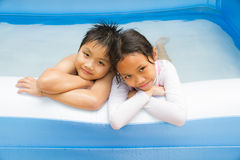Kids and Inflatable pool Royalty Free Stock Image