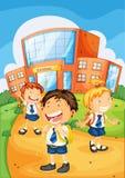 Kids infront of school Stock Images