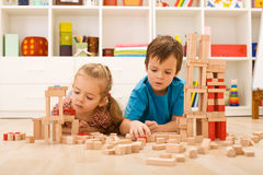 Kids inspecting their wooden block buildings Stock Images