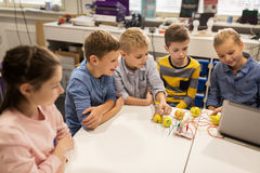 Kids with invention kit at robotics school stock images