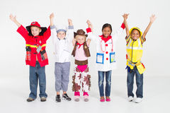 Kids with jobs. Group of cute little kids in various jobs uniforms teamwork sstudio shot royalty free stock image