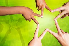 Kids joining fingers forming a star. Multiracial children's fingers touching to make star shape Stock Images