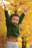 Kids jump in yellow autumn color Royalty Free Stock Photo
