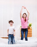 Kids jumping. Two kids jumping on bed Stock Photo