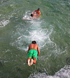 Kids jumping in the Atlantic ocean Royalty Free Stock Photo