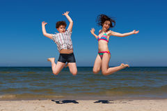 Kids jumping on beach Royalty Free Stock Photo