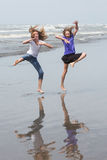 Kids jumping at the beach Stock Images