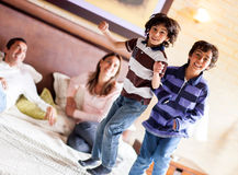 Kids jumping on the bed Royalty Free Stock Photos