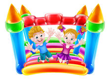 Kids Jumping on Bouncy Castle Royalty Free Stock Images