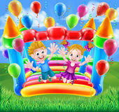 Kids Jumping on Bouncy Castle Stock Photo