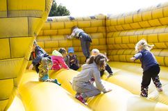 Kids jumping on castle. Action moment Stock Photography