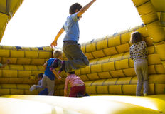 Kids jumping. On castle moment Royalty Free Stock Photos