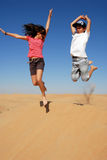 Kids jumping in the desert Royalty Free Stock Photos
