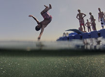 Kids jumping from floating sea platform Royalty Free Stock Photos