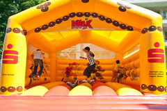 Kids jumping on an inflatable trampoline. Stock Image