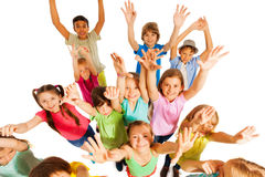 Kids jumping and lifting hands in the air. Funny bunch of kids jumping and lifting hands in the air cheering and screaming isolated on white Royalty Free Stock Images