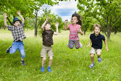 Kids Jumping in a orchard Royalty Free Stock Photography