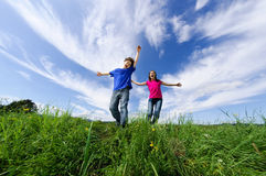 Kids jumping outdoor. Kids jumping against blue sky Stock Image