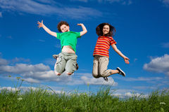 Kids jumping outdoor Royalty Free Stock Image