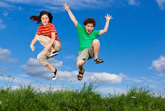Kids jumping outdoor Royalty Free Stock Photos