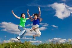 Kids jumping outdoor stock photos