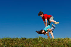 Kids jumping outdoor Stock Photography