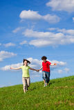 Kids jumping outdoor. Kids jumping against blue sky Royalty Free Stock Photos